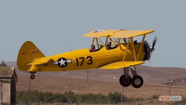 Stearman N54173 and Andreas Hotea about to land in Hollister