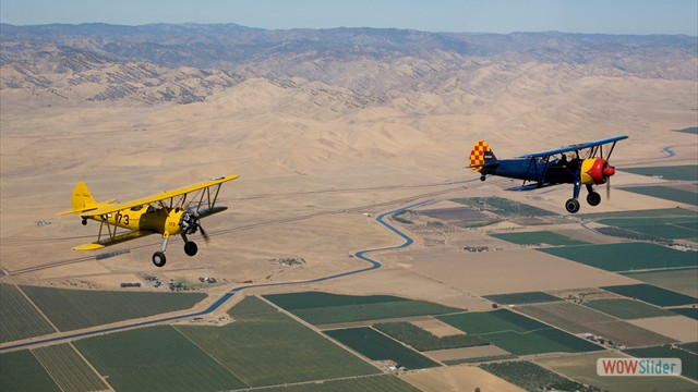 Stearman N54173 and Andreas Hotea in loose Formation-in Central Valley-1