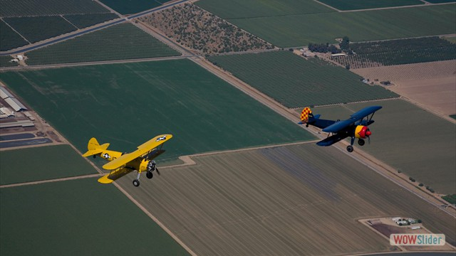 Stearman N54173 and Andreas Hotea in loose Formation-in Central Valley-2